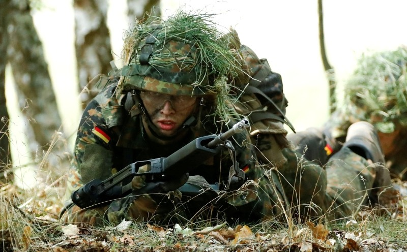 A German Bundeswehr armed forces recruit of the Mechanized Infantry Battalion 411 takes position during a drill at a military training area in Viereck, Germany, August 8, 2018. (Reuters Photo)
