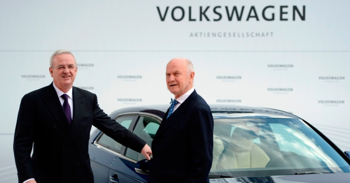 In this file photo taken on April 23, 2012, then Volkswagen CEO Martin Winterkorn (L) and then chairman of the supervisory board of Ferdinand Piech pose next to an Audi A3 electric car at the VW plant in Wolfsburg, Germany. (AFP Photo)