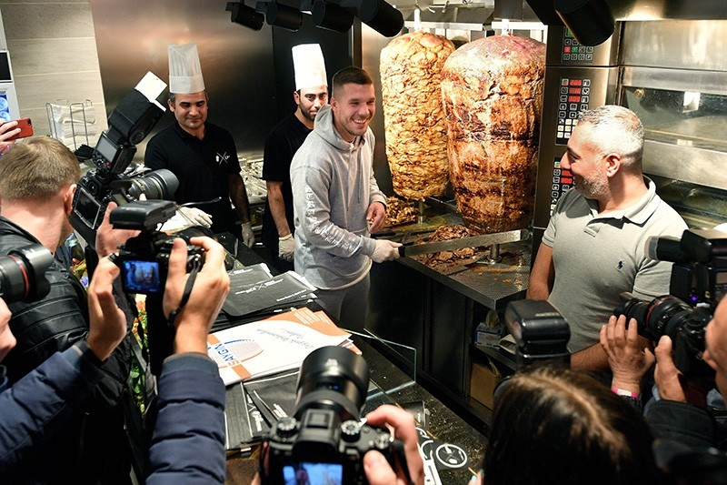 German soccer player Lukas Podolski (C) poses as he attends the opening of his 'Mangal Doener' kebab shop in Cologne, Germany, 06 January 2018. (EPA Photo)