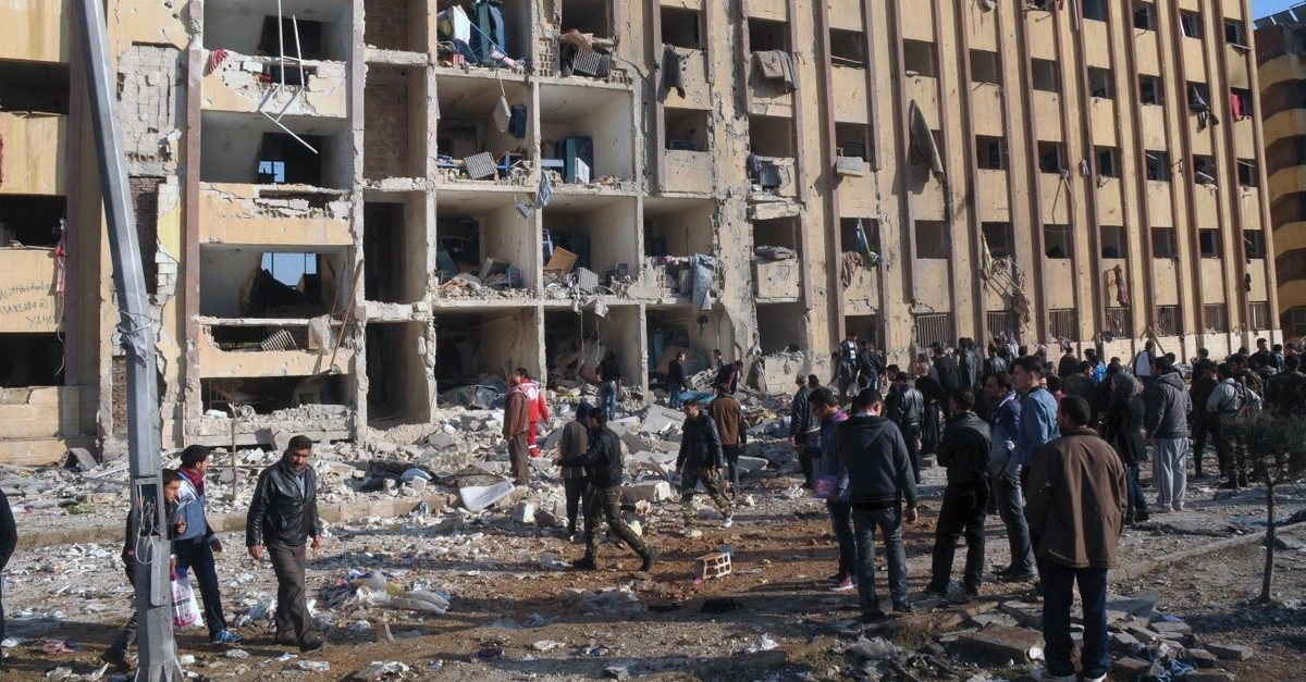 Civilians gather at the site of two explosions that rocked the University of Aleppo in Syria's second-largest city, Jan. 15, 2013.