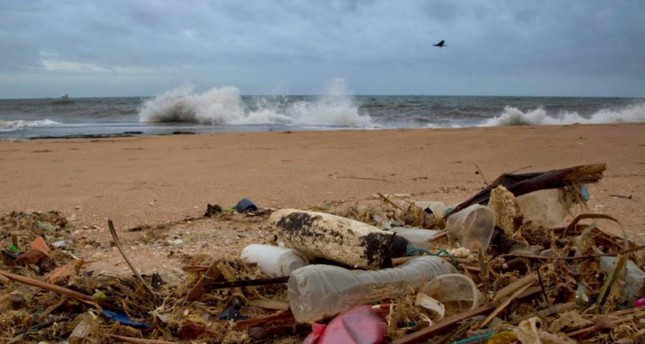 In this Aug. 13, 2015, file photo, a plastic bottle lies among other debris washed ashore on the Indian Ocean beach in Uswetakeiyawa, north of Colombo, Sri Lanka. AP File Photo