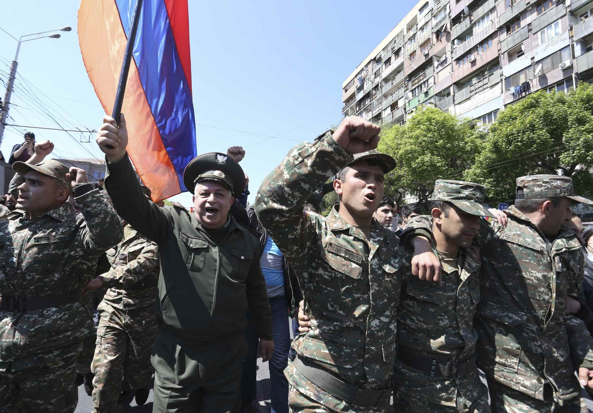 People march during a protest against the appointment of ex-president Serzh Sarksyan as the new prime minister in Yerevan, Armenia April 23, 2018. (REUTERS Photo)