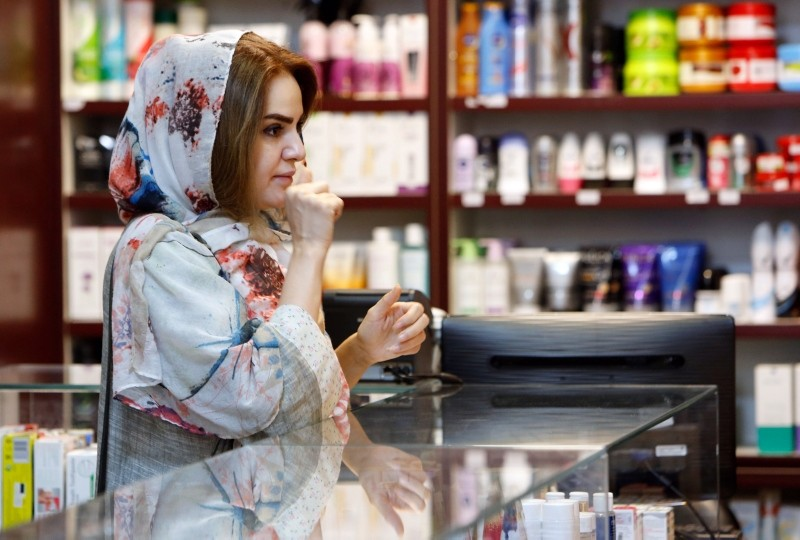An Iranian woman shops at a drugstore at the Nikan hospital in Tehran on Sept. 11, 2018. (AFP Photo)