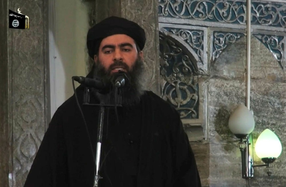 A file image grab taken from a propaganda video released on July 5, 2014 by al-Furqan Media allegedly shows al-Baghdadi in Mosul