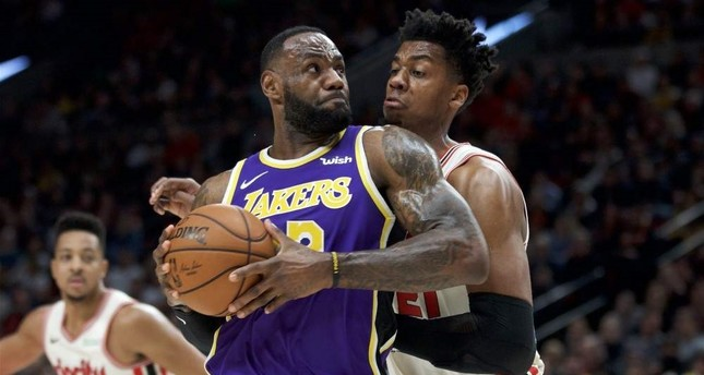 LeBron James drives to the basket around Trail Blazers center Hassan Whiteside during the first half in Portland, Dec. 28, 2019. AP Photo