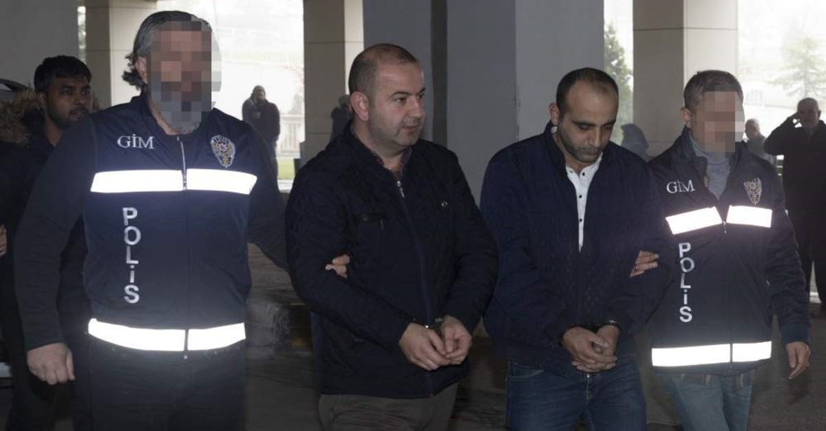 Police escort two Pakistani human smuggling suspects to the police station, Edirne, Dec. 20, 2019. (AA Photo)