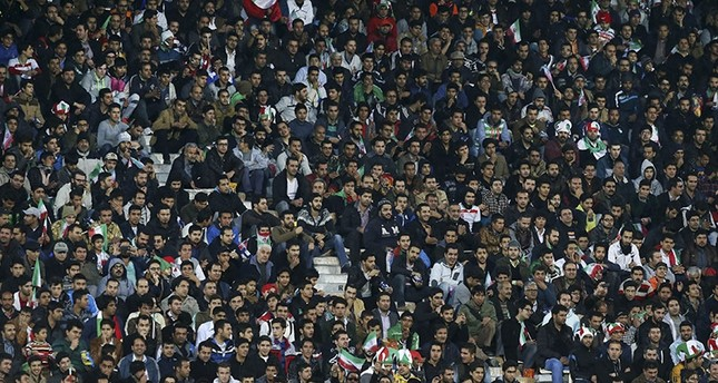 Iranian soccer fans follow a friendly match of Iran. 2014. (AP Photo)