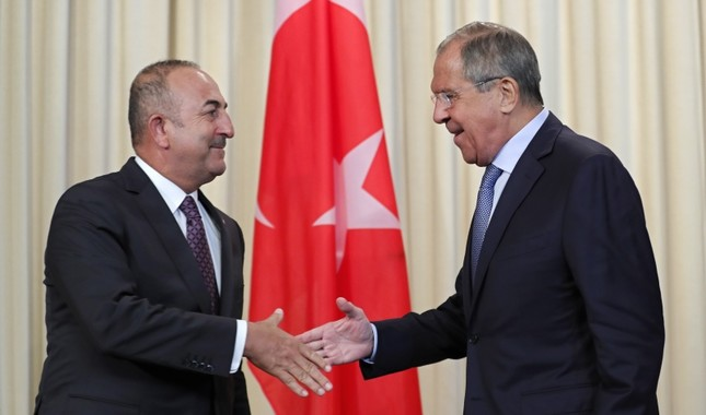 Foreign Minister Mevlüt Çavuşoğlu, left, shakes hands with Russian Foreign Minister Sergei Lavrov after their joint news conference following their talks in Moscow, Russia, Aug. 24, 2018. (EPA Photo)