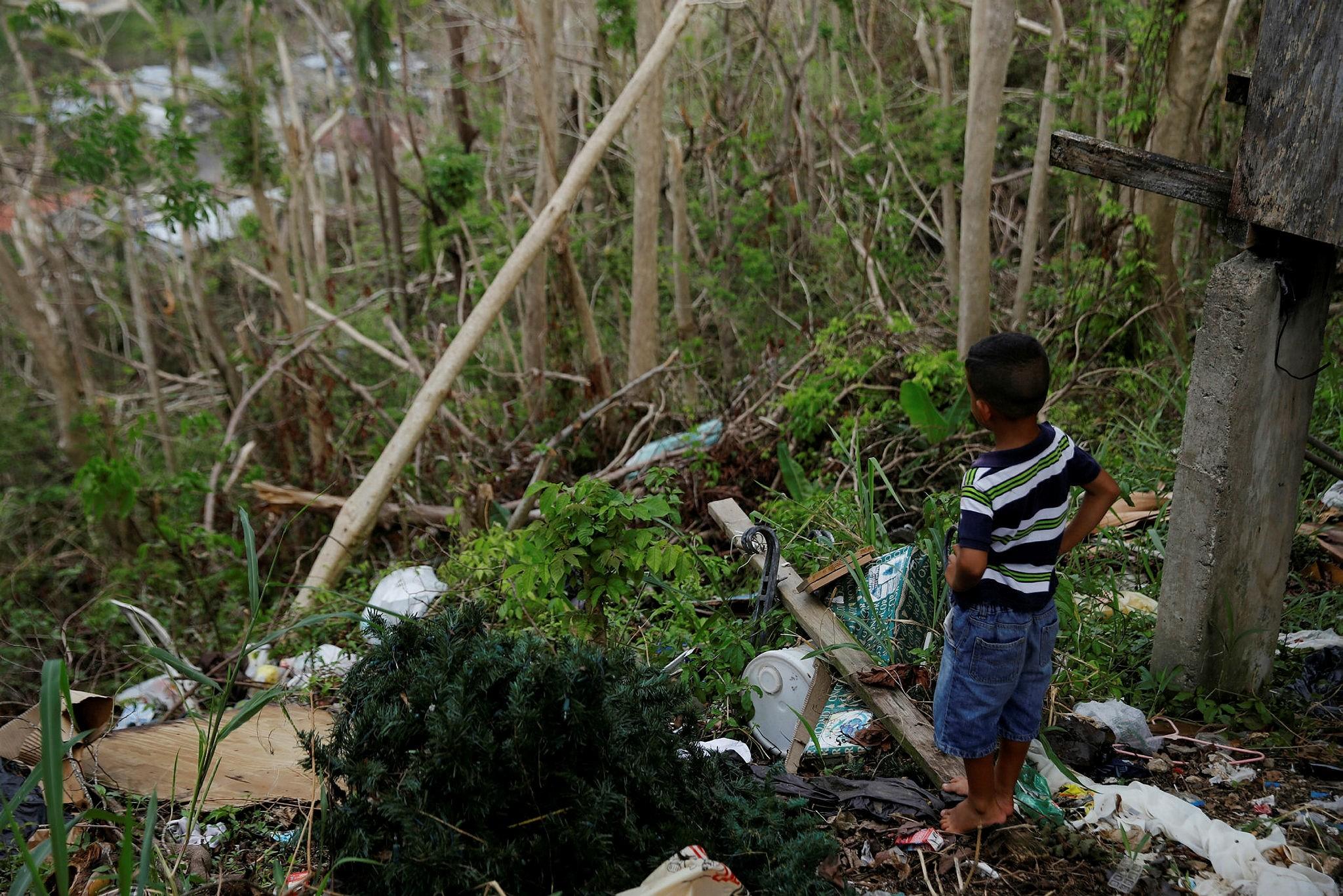 Yadriel Manuel, 6, looks outside a home damaged by Hurricane Maria in the Trujillo Alto municipality outside San Juan, Puerto Rico, October 9, 2017. (Reuters Photo)