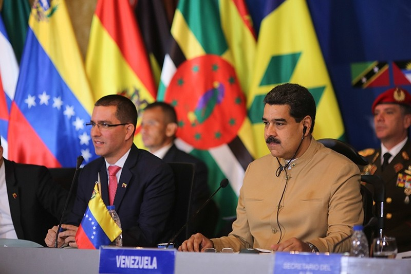 Venezuelan President Nicolas Maduro (R), next to Venezuelan Foreign Minister Jorge Arreaza (L), taking part in a session of foreign ministers of the intergovernmental organization Bolivarian Alliance for the Peoples of Our America (EPA Photo)