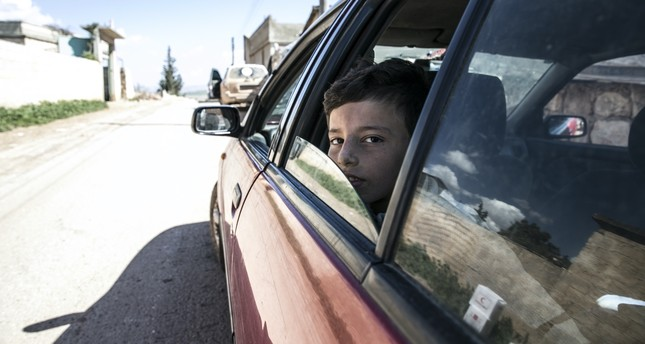 A Syrian child looks out from a car after being saved by Turkish soldiers from YPG terrorists as part of Operation Olive Branch going on since Jan. 20.