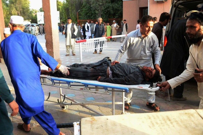 Afghan volunteers carry an injured man on a stretcher to an hospital following a suicide bomber blew himself in Jalalabad on June 16, 2018. (AFP Photo)