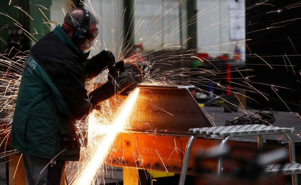 A worker grinds metal at the machine-building company Zemmler Siebanlagen in Massen, Germany.