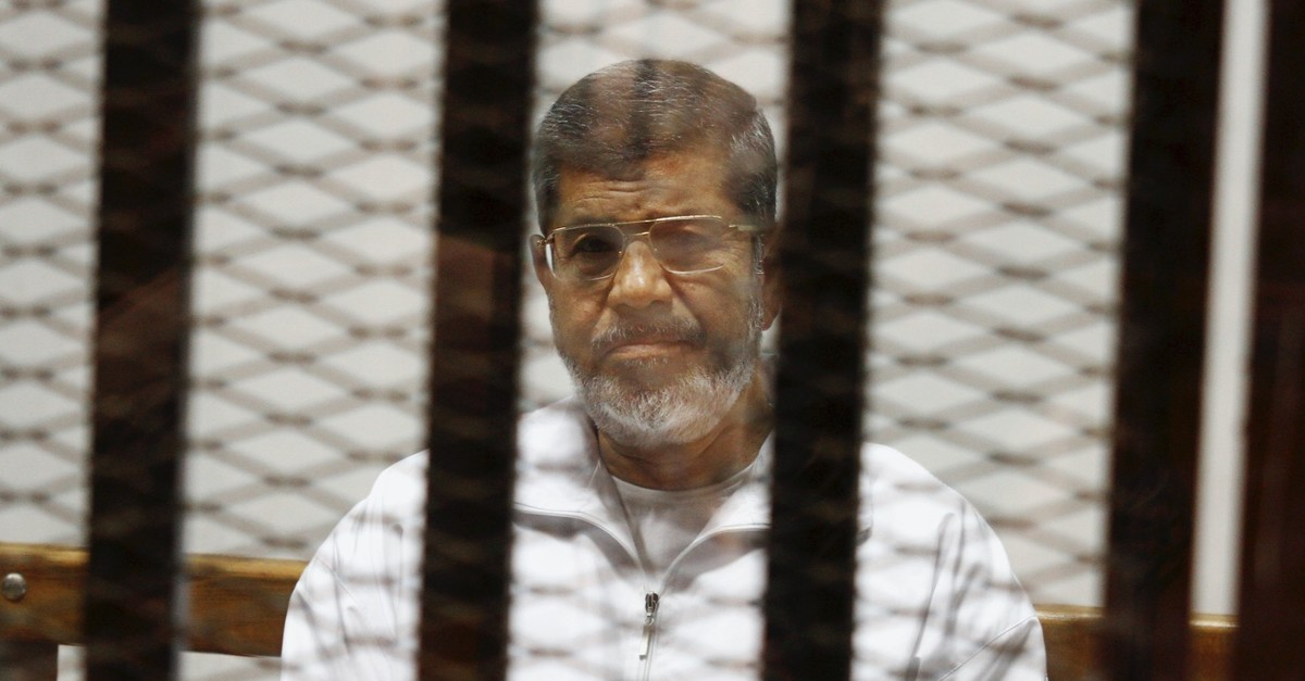 Egyptu2019s first democratically-elected President Mohammed Morsi sits in a defendant cage in the Police Academy courthouse, Cairo, May 8, 2014.