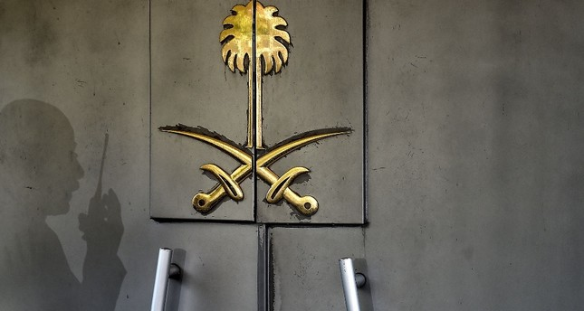 The shadow of a member of the security staff at the Saudi Consulate in Istanbul falls across the door of the consulate building, Nov. 1.