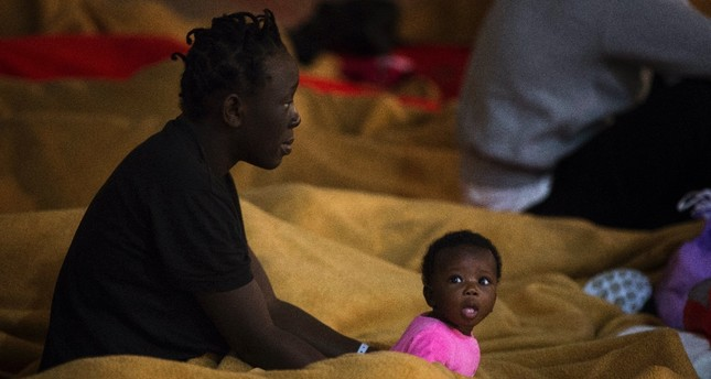 Migrants rest at a makeshift emergency center at Barbate's municipal sports center in the south of Spain, June 29.
