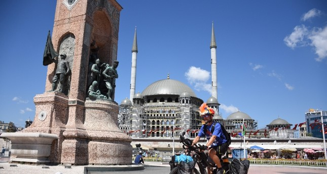 South African cyclist Grant Cameron-Smith pictured in Istanbul's famous Taksim Square (AA Photo)