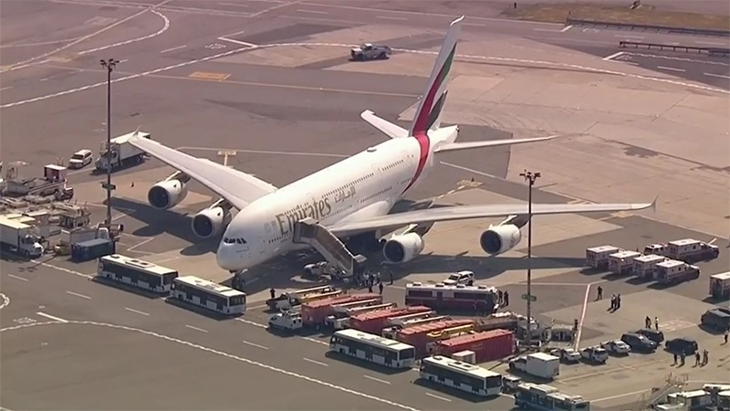 An Emirates Airbus A380 airplane quarantined at John F. Kennedy airport with several ambulances on standby, Sept. 5, 2018. (AP Photo)