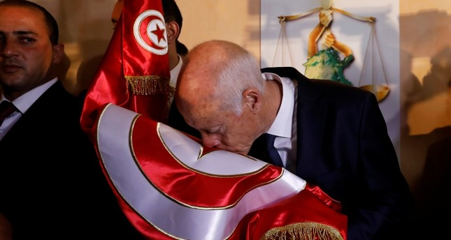Tunisian presidential candidate Kais Saied celebrates his victory in the Tunisian presidential election in the capital Tunis, Tunisia, Oct. 13, 2019. Reuters Photo