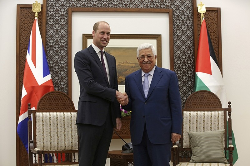 Britain's Prince William, left, shakes hands with Palestinian President Mahmoud Abbas in the West Bank City of Ramallah, Wednesday, June 27, 2018. (AP Photo)