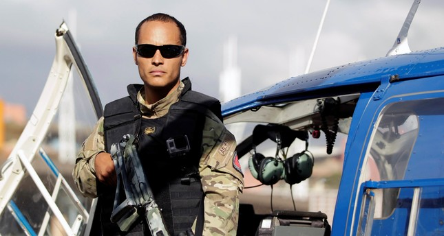 Police official Oscar Perez poses for photographs during an event of the Body of Scientific, Penal and Criminal Investigation (CICPC) in Caracas, Venezuela March 1, 2015. (REUTERS Photo)