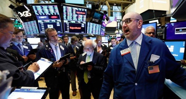 Specialist Peter Giacchi, right, calls out prices on the New York Stock Exchange trading floor before the Slack IPO, Thursday, June 20, 2019. (AP Photo)