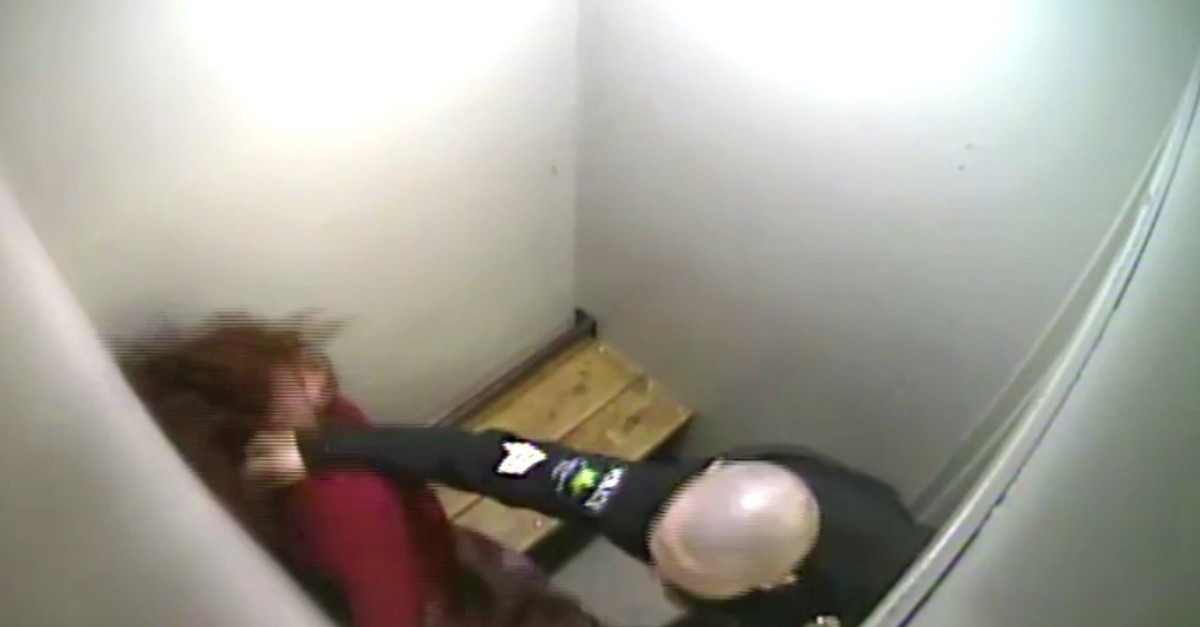 Screengrab from video shows Sgt. Jason Lawton punching Amy Connelly in detention in Vermont, March 15, 2019. (AP Video)