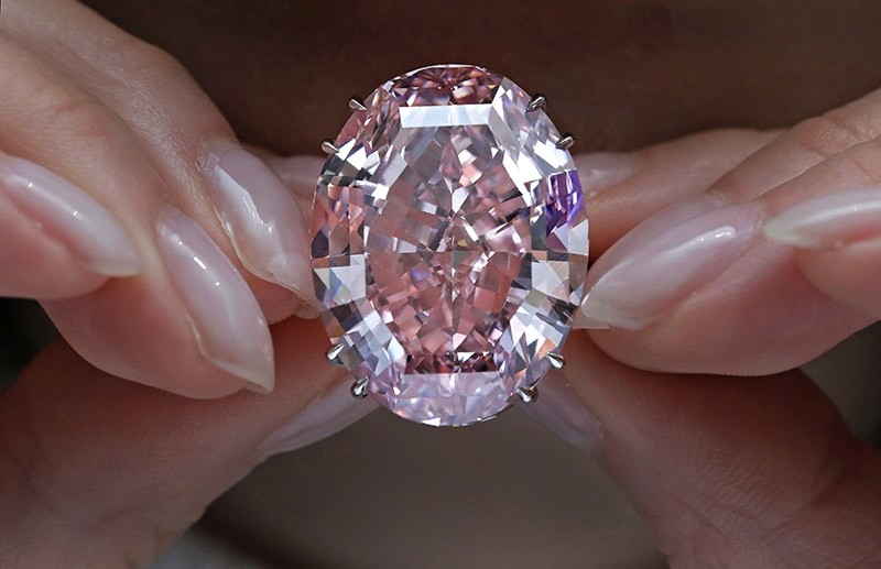 In this Wednesday, March 29, 2017, file photo, the ,Pink Star, diamond, the most valuable cut diamond ever offered at auction, is displayed by a model at a Sotheby's auction room in Hong Kong. (AP Photo)