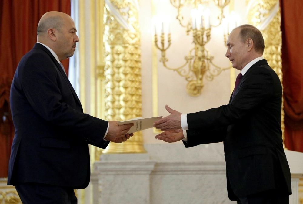 Russian President Vladimir Putin receives a letter of credence from Israeli ambassador to Russia Gary Koren during a ceremony at the Kremlin in Moscow, March 16.