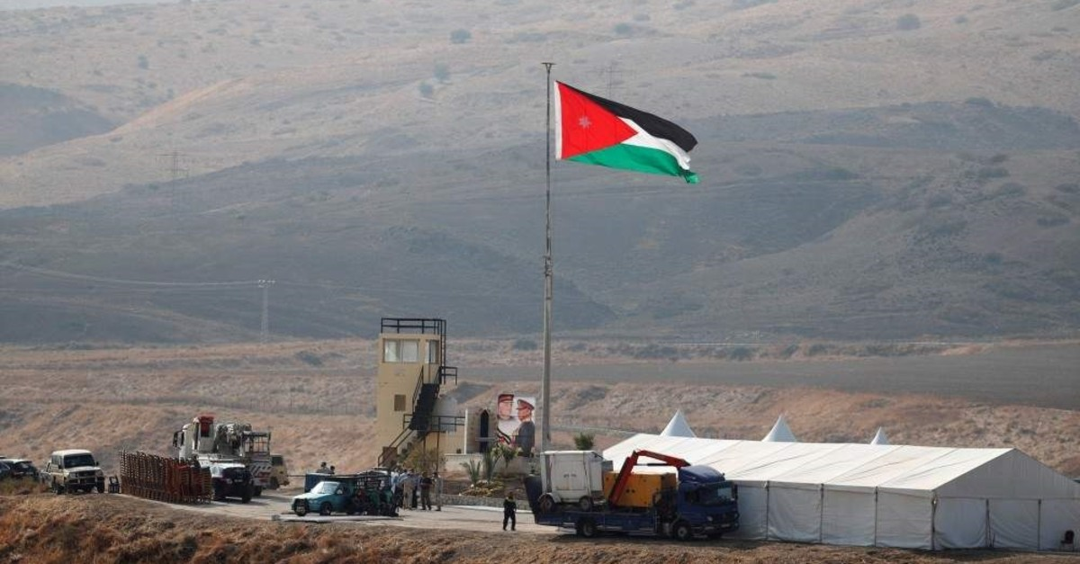 A Jordanian national flag is lifted near a tent in an area known as Al-Baquora, on the Jordanian side of the border with Israel, as seen from the Israeli side, Nov. 10, 2019. (Reuters Photo)