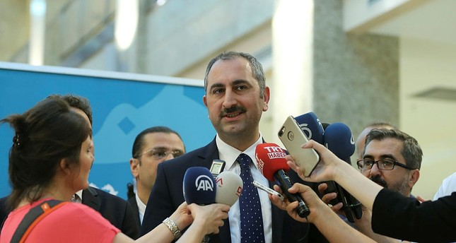 Justice Minister Abdulhamit Gül speaks to reporters after attending the court year opening day ceremony in Istanbul, on Friday, September 9, 2017. (AA Photo)