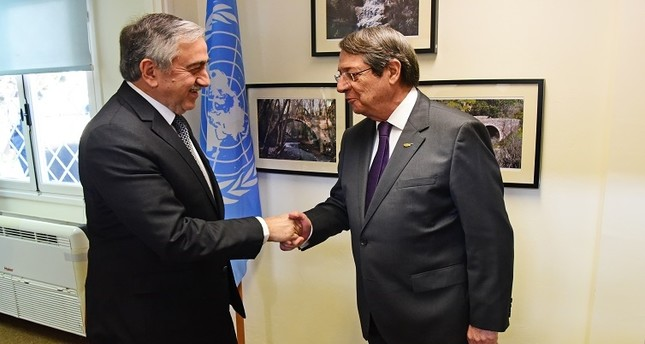 In this file photo provided by uncyprustalks.org, Turkish Cypriot President Mustafa Akıncı (L) and Greek Cypriot leader Nicos Anastasiades shake hands during a meeting.