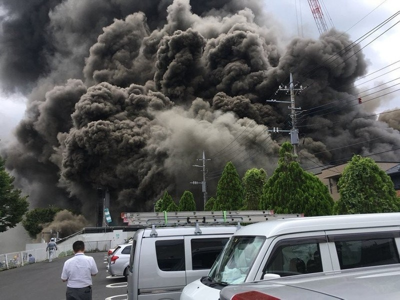 Smoke rising from a construction site on fire, in the western Tokyo city of Tama on July 26, 2018. (IHA Photo)