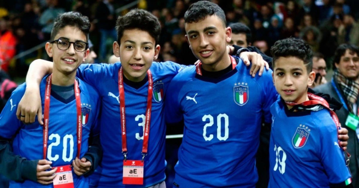 Ramy Shehata, second from right, and Adam El Hamami, left, pose with classmates prior to a Euro 2020 Group J qualifying soccer match between Italy and Liechtenstein, at the Ennio Tardini stadium in Parma, Italy, Tuesday, March 26, 2019. (AP Photo)