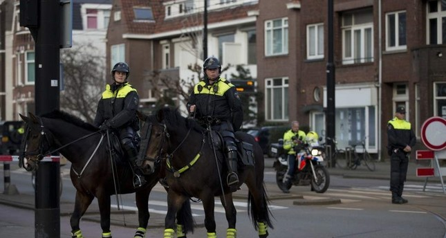 Dutch mounted police patrols as other police officers block the road AP File Photo