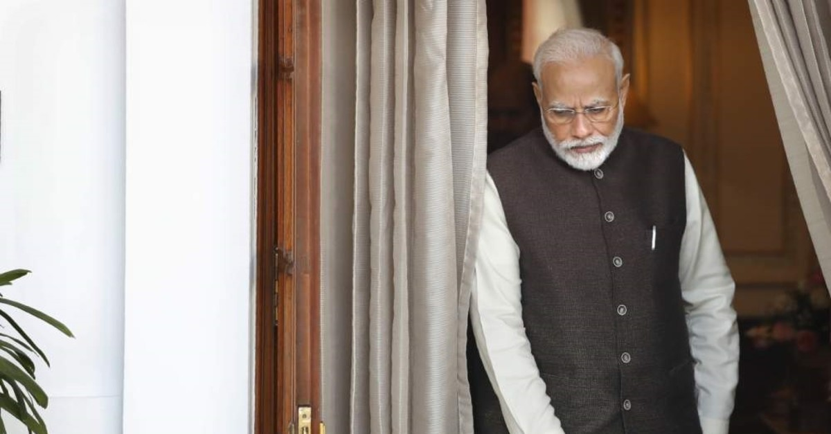 Indian Prime Minister Narendra Modi leaves the room to receive Portuguese President Marcelo Rebelo de Sousa, New Delhi, Feb. 14, 2020. (AP Photo)