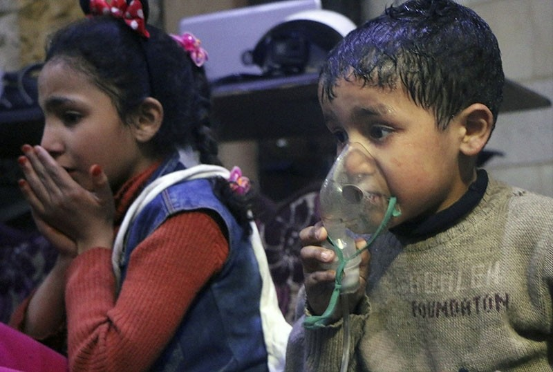 This image released early Sunday, April 8, 2018 by the Syrian Civil Defense White Helmets, shows a child receiving oxygen through respirators following an alleged poison gas attack in the town of Douma, near Damascus, Syria. (White Helmets via AP)