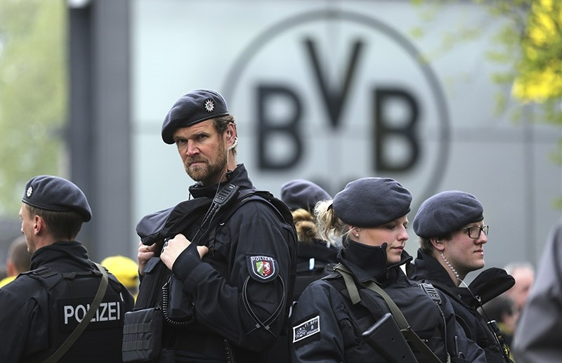 Police guard at the entrance of the Dortmund stadium prior to the German Bundesliga soccer match between Borussia Dortmund and Eintracht Frankfurt, in Dortmund, Saturday, April 15, 2017. (AP Photo)