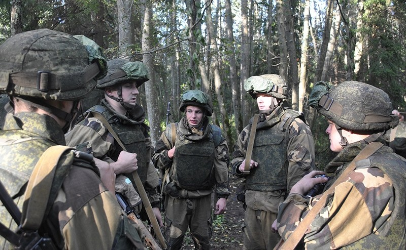 In this photo taken on Thursday, Sept. 14, 2017, Belarusian soldiers talk during the war games at an undisclosed location in Belarus. (AP Photo)