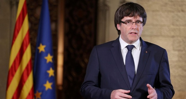 Catalan President Carles Puigdemont gives a speech at the Palau de la Generalitat, the regional government headquarters in Barcelona, Spain, October 21, 2017. Reuters Photo