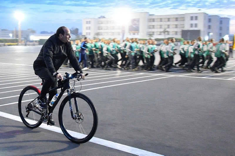 Egyptian President Abdel Fattah Al Sisi rides a bicycle during a follow-up on training and rehabilitation programs at the Military Academy in Cairo, Egypt, February 19, 2018 in this handout picture. (The Egyptian Presidency/Handout via Reuters)