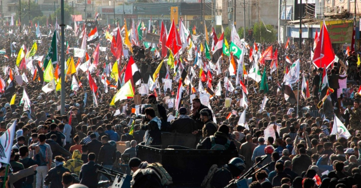 Iraqi mourners welcome the body of Abu Mahdi al-Muhandis, the slain chief of Hashd al-Shaabi, an Iraqi paramilitary force with close ties to Iran, in the southern city of Basra after it came from Iran on Jan. 7, 2020 ahead on his burial. (AFP Photo)