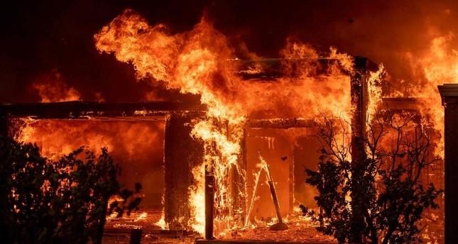 Flames consume a home during the Kincade fire as flames race through Healdsburg, California on October 27, 2019. (AFP Photo)