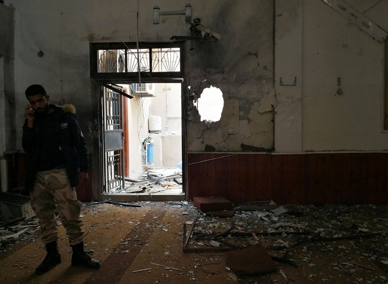 A member of the Libyan National Army speaks on a mobile phone inside a mosque damaged in a twin bombing in Benghazi, Libya February 9, 2018 (Reuters Photo)