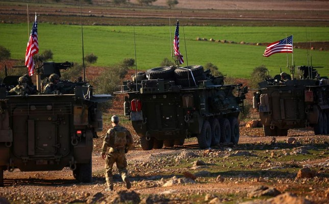 A convoy of U.S. armored vehicles drive near the village of Yalanli, on the western outskirts of the northern Syrian city of Manbij, March 5, 2017.