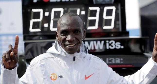 Eliud Kipchoge celebrates winning the 45th Berlin Marathon in Berlin, Germany, Sunday, Sept. 16, 2018. (AP Photo)