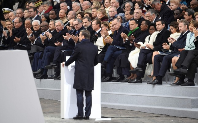 World leaders listen to French President Emmanuel Macron delivering a speech during in a ceremony at the Arc de Triomphe in Paris on Nov. 11, 2018 as part of commemorations marking 100th anniversary of the armistice ending World War I. (AFP Photo)