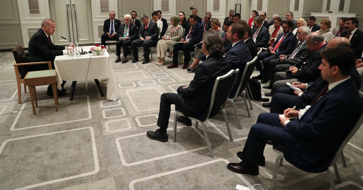 President Recep Tayyip Erdou011fan addresses accompanying Turkish journalists in Osaka, June 29, 2019.