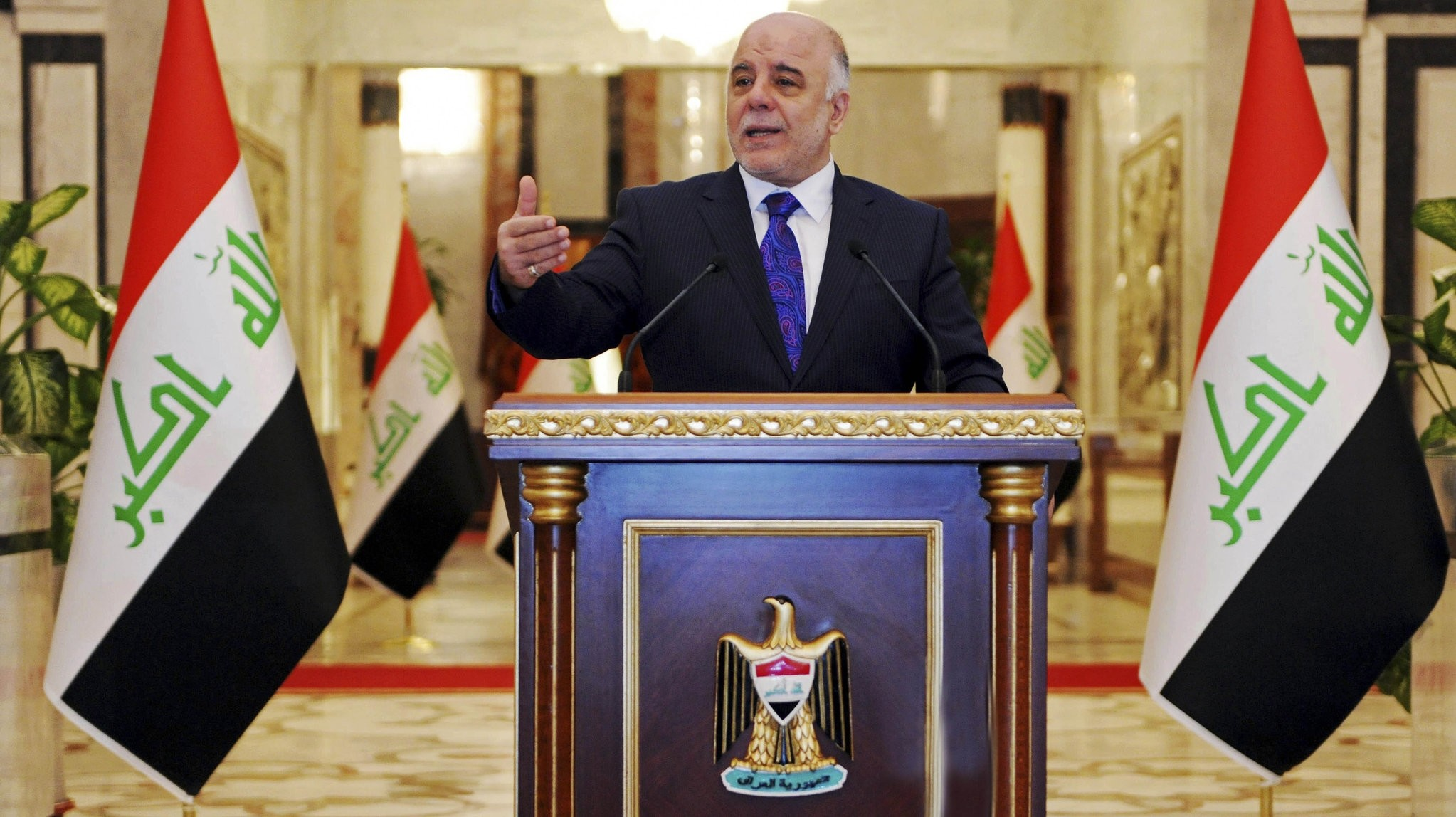 Iraqi premier-designate Haider al-Abadi speaks at his first press conference since accepting the nomination to be Iraqu2019s next prime minister, in Baghdad, Iraq, Aug. 25, 2014. (AP Photo)