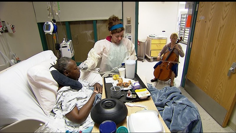 In this Oct. 11, 2017, cellist Martha Vance plays for a patient at Medstar Georgetown University Hospital in Washington DC. (AP Photo)